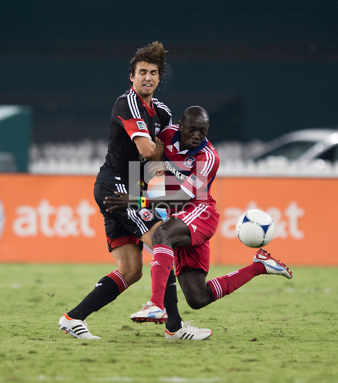 Dejan Jakovic (5) of D.C. United collides with Dominic Oduro (8) of the Chicago Fire at RFK Stadium in Washington, DC.  D.C. United defeated the Chicago Fire, 4-2.