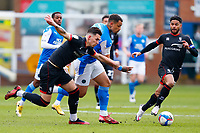 1st May 2021; Weston Homes Stadium, Peterborough, Cambridgeshire, England; English Football League One Football, Peterborough United versus Lincoln City; Jonson Clarke-Harris of Peterborough United attempts to break free from Lewis Montsma of Lincoln City