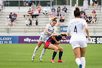 CARY, NC - APRIL 10: Meredith Speck #25 of the NC Courage heads the ball over Ashley Hatch #33 of the Washington Spirit during a game between Washington Spirit and North Carolina Courage at Sahlen's Stadium at WakeMed Soccer Park on April 10, 2021 in Cary, North Carolina.