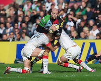 George Robson of Harlequins is tackled by Will Fraser (left) and Ernst Joubert of Saracens during the Aviva Premiership match between Harlequins and Saracens at the Twickenham Stoop on Sunday 30th September 2012 (Photo by Rob Munro)