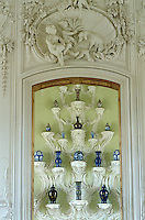 A view into the porcelain room where Qing dynasty vases are displayed on Rococo consoles sculpted by Johann Michael Graff who also created the scene above the door