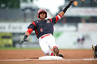Batavia Muckdogs third baseman J.C. Millan (4) slides into third base on a triple in the bottom of the first inning during a game against the Lowell Spinners on July 12, 2017 at Dwyer Stadium in Batavia, New York.  Batavia defeated Lowell 7-2.  (Mike Janes/Four Seam Images)