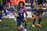 30th August 2020, San Sebastien, Spain;  Wendie Renard of Lyon celebrates with trophy after winning the UEFA Womens Champions League football match Final between VfL Wolfsburg and Olympique Lyonnais 3-1