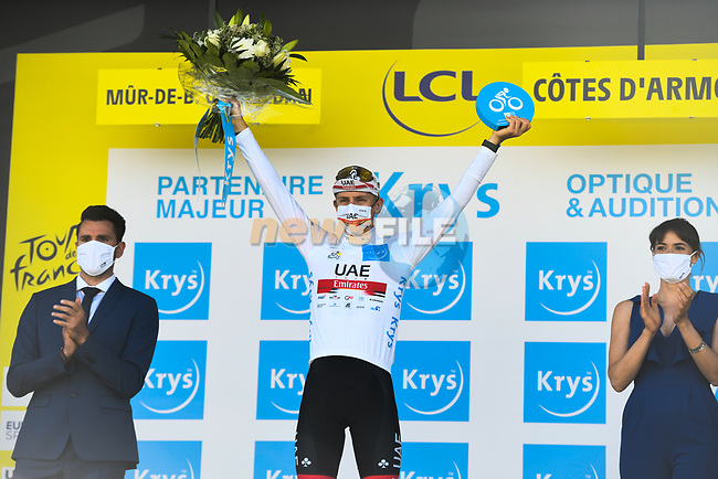 Tadej Pogacar (SLO) UAE Team Emirates retains the young riders White Jersey at the end of Stage 2 of the 2021 Tour de France, running 183.5km from Perros-Guirec to Mur-de-Bretagne Guerledan, France. 27th June 2021.  <br /> Picture: A.S.O./Charly Lopez | Cyclefile<br /> <br /> All photos usage must carry mandatory copyright credit (© Cyclefile | A.S.O./Charly Lopez)