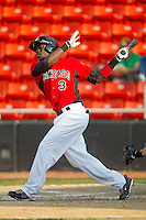 Guillermo Pimentel #3 of the Hickory Crawdads follows through on his swing against the Greensboro Grasshoppers at  L.P. Frans Stadium July 10, 2010, in Hickory, North Carolina.  Photo by Brian Westerholt / Four Seam Images