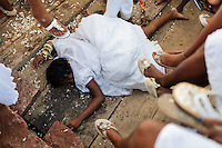 A Candomblé faithful becomes possessed during the ritual ceremony in honor to Yemanjá, the goddess of the sea, in Cachoeira, Bahia, Brazil, 5 February 2012. Yemanjá, originally from the ancient Yoruba mythology, is one of the most popular ?orixás?, the deities from the Afro-Brazilian religion of Candomblé. Every year on February 5th, hundreds of Yemanjá devotees participate in a colorful celebration in her honor. Faithful, usually dressed in the traditional white, gather on the banks of Paraguaçu river to leave offerings for their goddess. Gifts for Yemanjá include flowers, perfumes or jewelry. Dancing in the circle and singing ancestral Yoruba prayers, sometimes the followers enter into a trance and become possessed by the spirits. Although Yemanjá is widely worshipped throughout Latin America, including south of Brazil, Uruguay, Cuba or Haiti, the most popular cult is maintained in Bahia, Brazil.