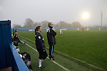 Leeds United Ladies 1 Nottingham Forest Ladies 1, 13/11/2011. Throstle Nest, FA Premier League National Division. Leeds United Ladies FC manager Chris Welburn (right) and coach Claire Robinson watching the action during the second half against Nottingham Forest Ladies FC in an FA Premier League National Division fixture at the Throstle Nest, Farsley, West Yorkshire. The match ended in a one-all draw, watched by fewer than 50 spectators at the club's regular home ground. Formed in 1989, Leeds United Ladies has been one of England's top women's sides for most of the last ten years and played in the top winter league for ladies' teams. Photo by Colin McPherson.
