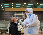 A mass screening AG Covid-19 test is conducted on all the population of South Tyrol at Bolzano, Bozen, on November 20, 2020. In each area of the city test units are set up as here in a school gymnasium. PIERRE TEYSSOT