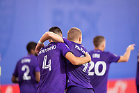 LAKE BUENA VISTA, FL - JULY 14: Joao Moutinho #4 and Chris Mueller #9 of Orlando City SC celebrate a goal during a game between Orlando City SC and New York City FC at Wide World of Sports on July 14, 2020 in Lake Buena Vista, Florida.