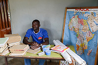 TOGO, Tohoun, school teacher with africa map