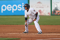 Wisconsin Timber Rattlers outfielder Brandon Diaz (5) leads off first base during a Midwest League game against the Beloit Snappers on May 30th, 2015 at Fox Cities Stadium in Appleton, Wisconsin. Wisconsin defeated Beloit 5-3 in the completion of a game originally started on May 29th before being suspended by rain with the score tied 3-3 in the sixth inning. (Brad Krause/Four Seam Images)