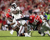ATHENS, GA - SEPTEMBER 18: ZaQuandre White #11 spins away from a tackle by Jordan Davis #99 before a game between South Carolina Gamecocks and Georgia Bulldogs at Sanford Stadium on September 18, 2021 in Athens, Georgia.