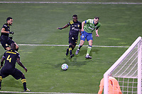 COLUMBUS, OH - DECEMBER 12: Brad Smith #2 of the Seattle Sounders FC sends a cross past Harrison Afful #25 of the Columbus Crew during a game between Seattle Sounders FC and Columbus Crew at MAPFRE Stadium on December 12, 2020 in Columbus, Ohio.