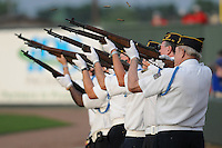 Shells fly as an honor guard fires a 21-gun salute during Military Apperciation Day prior to a game between the West Virginia Powerand the Greenville Drive on May 19, 2012, at Fluor Field at the West End in Greenville, South Carolina. (Tom Priddy/Four Seam Images)