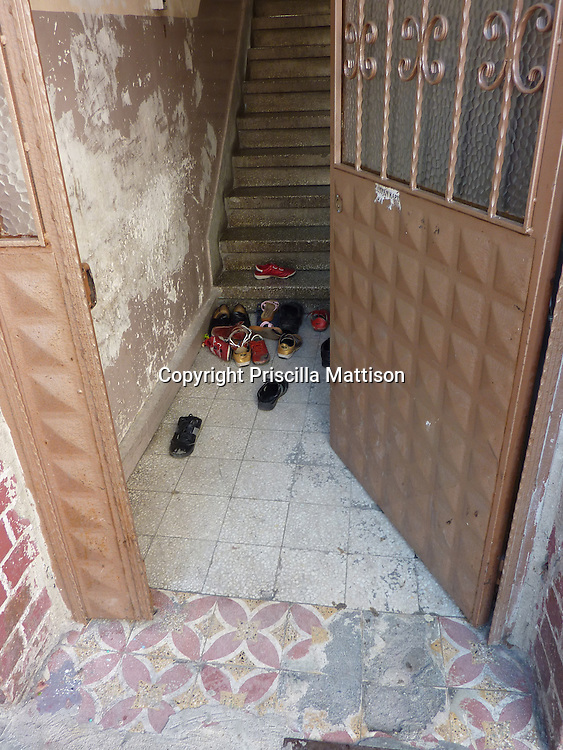 Istanbul, Turkey - September 23, 2009:  Shoes are piled in an entryway.