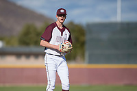 Mountain Ridge Mountain Lions starting pitcher Matthew Liberatore (32) prepares to deliver a pitch during a game against the Boulder Creek Jaguars at Mountain Ridge High School on February 28, 2018 in Glendale, Arizona. Liberatore collected 14 strikeouts in his first appearance of the spring, leading the Mountain Lions to a 6-3 conference victory. (Zachary Lucy/Four Seam Images)