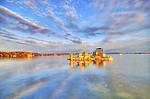 Spectacular sky and reflection of houseboat in Yellowknife Bay