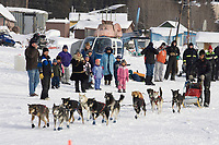 Lance Mackey leaves to a cheering crowd at the White Mountain checkpoint on tuesday afternoon during Iditarod 2008