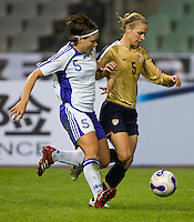 USWNT forward (5) Lindsay Tarpley fights past Finland's (5) Tiina Salmen during the Four Nations Tournament in  Guangzhou, China.  The US defeated Finland, 4-1.