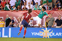 Christian Bermudez (21) of Mexico gets out of shape going up for a header with Kyle Beckerman (7) of the United States. The men's national teams of the United States (USA) and Mexico (MEX) played to a 1-1 tie during an international friendly at Lincoln Financial Field in Philadelphia, PA, on August 10, 2011.