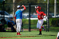 Gabriel Arias (1) is congratulated after hitting a home run during the Dominican Prospect League Elite Florida Event at Pompano Beach Baseball Park on October 14, 2019 in Pompano beach, Florida.  (Mike Janes/Four Seam Images)