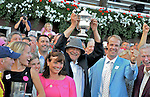 5 September 2009:Rachel Alexandra owner Jess Jackson holds up the winner's trophy for the Woodward Stakes at Saratoga Race Track in Saratoga Springs, New York