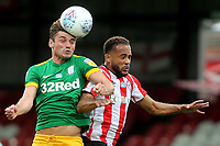 Ryan Ledson of Preston North End out jumps Brentford's Bryan Mbeumo and heads the ball upfield during Brentford vs Preston North End, Sky Bet EFL Championship Football at Griffin Park on 15th July 2020
