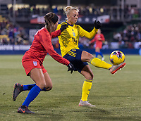COLUMBUS, OH - NOVEMBER 07: Mallory Pugh #2 of the United States defends Hanna Bennison #14 of Sweden during a game between Sweden and USWNT at Mapfre Stadium on November 07, 2019 in Columbus, Ohio.
