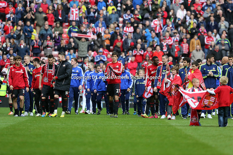 Pictured: Sunderland players and members of staff thank their supporters after the final whistle. Sunday 11 May 2014<br /> Re: Barclay's Premier League, Sunderland v Swansea City FC at the Stadium of Light, Sunderland, UK.