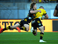 Hurricanes' Luke Campbell scores in the flying tackle of Damien McKenzie during the Super Rugby Aotearoa match between the Hurricanes and Chiefs at Sky Stadium in Wellington, New Zealand on Saturday, 20 March 2020. Photo: Dave Lintott / lintottphoto.co.nz