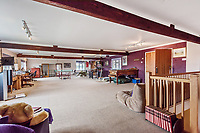 BNPS.co.uk (01202 558833)<br /> Pic: KnightFrank/BNPS<br /> <br /> Pictured: Games room.<br /> <br /> An impressive family home built in an 'industrial scale' oast house with multiple circular rooms is on the market for £1.6m.<br /> <br /> The property is one half of a massive former six roundel oast house that has been expanded and renovated by the current owners.<br /> <br /> Estate agents Knight Frank say the roundels are far larger than normally seen in most oast houses, which means the property has quirky character while also being a practical family home.<br /> <br /> This six-bedroom house is in the picturesque Kent countryside, but just 1.5 miles from the village of Hadlow and ten minutes' drive from the bigger town of Tonbridge.