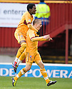 MOTHERWELL'S HENRIK OJAMAA CELEBARTES WITH OMAR DALEY AFTER HE SCORES MOTHERWELL'S SECOND GOAL