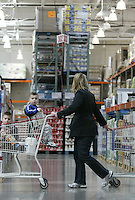 Stacey Brewster, of Columbus, with her sons Ben, left, Jake, center, and Harrison, back, shop at a Costco Wholesale Warehouse Friday, March 9, 2007 in Columbus, Ohio.
