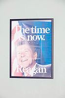 """A 1980 campaign poster for Ronald Reagan reading """"The time is now,"""" hangs on a wall in the office of the New Hampshire Republican State Committee in Concord, New Hampshire, on Wed., Sept. 16, 2020."""