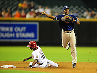 Aug. 30, 2010; Phoenix, AZ, USA; San Diego Padres shortstop Miguel Tejada throws to first base after forcing out Arizona Diamondbacks base runner (10) Justin Upton in the first inning at Chase Field. Mandatory Credit: Mark J. Rebilas-