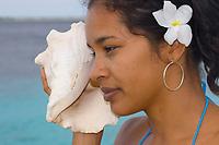 young womanm, listening to seashell, Bonaire, Netherlands Antilles, Caribbean Sea, Atlantic Ocean