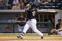 Carlos Sanchez (13) of the Charlotte Knights follows through on his swing against the Pawtucket Red Sox at BB&T Ballpark on August 9, 2014 in Charlotte, North Carolina.  The Red Sox defeated the Knights  5-2.  (Brian Westerholt/Four Seam Images)