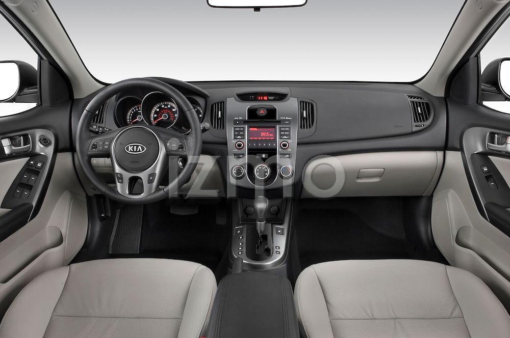 Straight dashboard view of a 2010 Kia Forte EX.