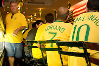 """Brazil fans cheer on their team in a match against Australia on June 18, 2006 at the Emporium, a restaurant in a section of New York City known as """"Little Brazil"""".<br /> <br /> The World Cup, held every four years in different locales, is the world's pre-eminent sports tournament in the world's most popular sport, soccer (or football, as most of the world calls it).  Qualification for the World Cup is open to any country with a national team accredited by FIFA, world soccer's governing body. The first World Cup, organized by FIFA in response to the popularity of the first Olympic Games' soccer tournaments, was held in 1930 in Uruguay and was participated in by 13 nations.    <br /> <br /> As of 2010 there are 208 such teams.  The final field of the World Cup is narrowed down to 32 national teams in the three years preceding the tournament, with each region of the world allotted a specific number of spots.  <br /> <br /> The World Cup is the most widely regularly watched event in the world, with soccer teams being a source of national pride.  In most nations, the whole country is at a standstill when their team is playing in the tournament, everyone's eyes glued to their televisions or their ears to the radio, to see if their team will prevail.  While the United States in general is a conspicuous exception to the grip of World Cup fever there is one city that is a rather large exception to that rule.  In New York City, the most diverse city in a nation of immigrants, the melting pot that is America is on full display as fans of all nations gather in all possible venues to watch their teams and celebrate where they have come from."""
