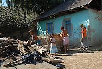 """ROMANIA, Tulcea, Viitorului Street, 2010/08/24.Half of the Roma families living in the district of Tulcea Viitorului, bordering the former industrial conglomerate, lives in France. This area is one of the poorest in the city without running water and sometimes no electricity. The street of """"future"""" is always paved. The families live mainly social benefits and hope all from one day to join Roma in Saint-Denis France). Here, a view inside a house.Families who have never been in France, are the poorest in the neighborhood..© Bruno Cogez / Est&Ost Photography..Roumanie, Tulcea, quartier de Viitorului, 24/08/2010.La moitié des familles roms vivant dans le quartier Viitorului de Tulcea, en bordure de l'ancien combinat industriel, vit en France. Ce quartier est un des plus pauvre de la ville, sans eau courante et parfois sans électricité. Les familles vivent principalement des allocations sociales et espèrent toutes partir un jour rejoindre les Roms de Saint-Denis. Les familles qui ne sont jamais allées en France sont les plus pauvres du quartier..© Bruno Cogez / Est&Ost Photography"""