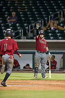 AZL Diamondbacks catcher Jose Herrera (23) tells right fielder Walter Higuera (1) not to slide during the game against the AZL Cubs on August 11, 2017 at Sloan Park in Mesa, Arizona. AZL Cubs defeated the AZL Diamondbacks 7-3. (Zachary Lucy/Four Seam Images)