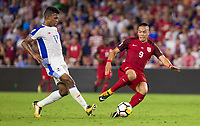 Orlando, FL - Friday Oct. 06, 2017: Luis Ovalle, Bobby Wood during a 2018 FIFA World Cup Qualifier between the men's national teams of the United States (USA) and Panama (PAN) at Orlando City Stadium.