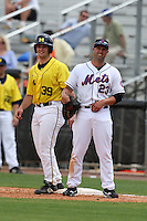 March 21, 2010:  Vinnie Sarafa (39) of the Michigan Wolverines at first with Chris Carter (23) of the NY Mets during a game at Tradition Field in St. Lucie, FL.  Photo By Mike Janes/Four Seam Images