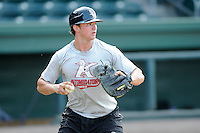 Catcher Mike Marjama (12) of the Kannapolis Intimidators before a game against the Greenville Drive on Monday, August 5, 2013, at Fluor Field at the West End in Greenville, South Carolina. Kannapolis won, 3-0. (Tom Priddy/Four Seam Images)