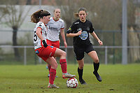 Zulte Waregem's forward Liesa Capiau (L) and Woluwe's Kenza Vrithof (R)  pictured during a female soccer game between SV Zulte - Waregem and White Star Woluwe on the 9th matchday of the 2020 - 2021 season of Belgian Scooore Women s SuperLeague , saturday 12 th of December 2020  in Waregem , Belgium . PHOTO SPORTPIX.BE | SPP | DIRK VUYLSTEKE