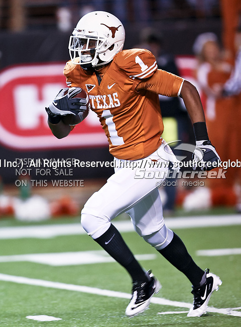 Texas Longhorns wide receiver Mike Davis (1) returns a kick off in the game between the Oklahoma State Cowboys and the University of Texas in Austin Texas Longhorns at the Daryl K. Royal- Texas Memorial Stadium in Austin, Texas. The Oklahoma State Cowboys defeated the Texas Longhorns 33 to 16.