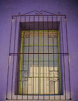 Purple Adobe - Green window with rusty grate - Arizona
