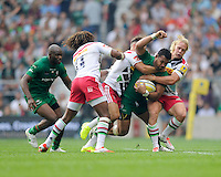 Ofisa Treviranus of London Irish is tackled by Marland Yarde, Danny Care and Matt Hopper of Harlequins during the Premiership Rugby Round 1 match between London Irish and Harlequins at Twickenham Stadium on Saturday 6th September 2014 (Photo by Rob Munro)