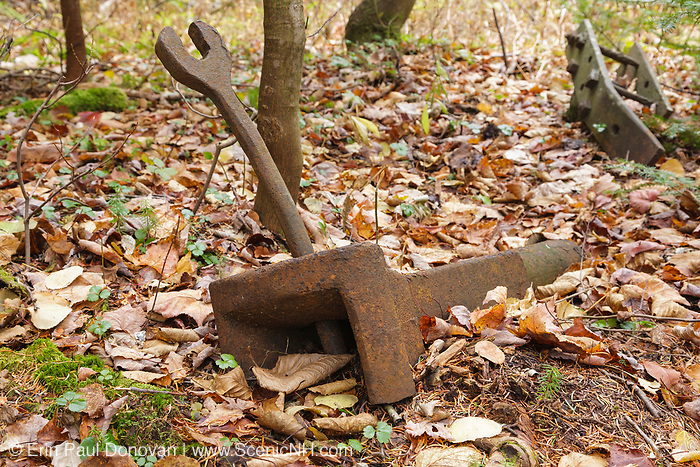 A protected artifact along the Beebe River Railroad (1917-1942), near logging Camp 11, in the Sandwich Range Wilderness of Waterville Valley, New Hampshire. This object is believed to be the coupler pocket for a link and pin style coupler. The link and pin coupler connected the log railroad cars to one another. The removal of historical artifacts from federal lands without a permit is a violation of federal law.