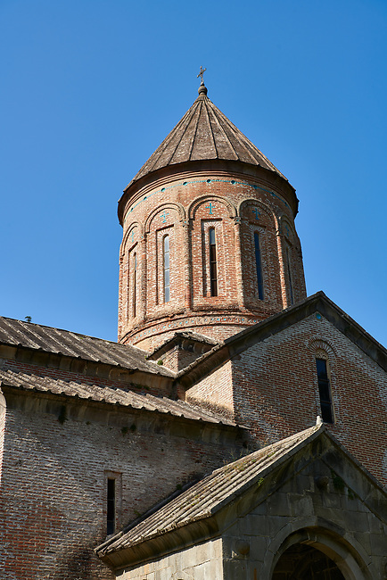 """Close up pictures & imagse of the cupola of Timotesubani medieval Orthodox monastery Church of the Holy Dormition (Assumption), dedcated to the Virgin Mary, 1184-1213, Samtskhe-Javakheti region, Georgia (country).<br /> <br /> Built during the reigh of Queen Tamar during the """"Golden Age of Georgia"""", Timotesubani Church of the Holy Dormition is one of the most important examples of medieval Georgian architecture and art. <br /> <br /> Built of pinkish Georgian brick to a cruciform floor plan. The eastern end of the church has 3 apses. Above the centre of the church is a high Georgian style cupola supported on 2 columns."""